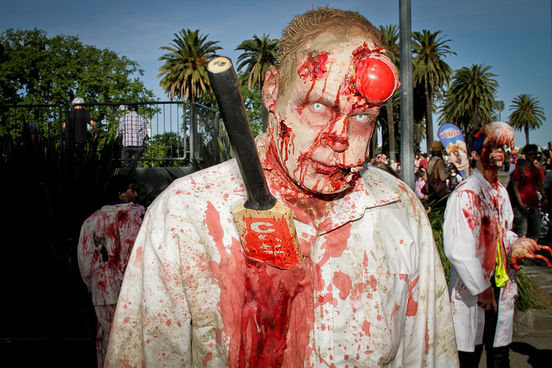 zombie with cicket ball stuck in head and cricket bat stuck in body